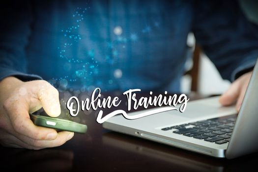 Online training distance learning concept - laptop and cellphone.