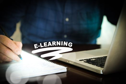 E-Learning computer and notebook - learning and education concept