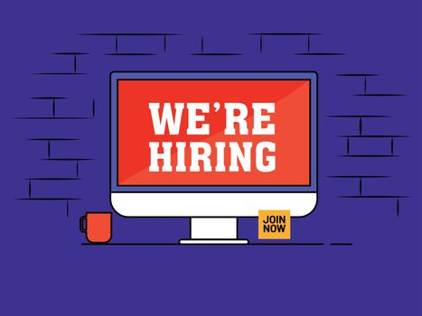 Online Job Vacancy by computer on purple brick wall background f
