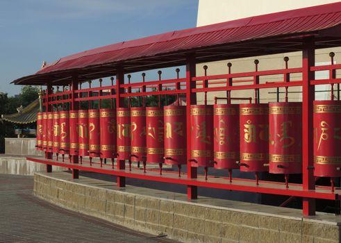 Prayer wheels at Buddhist temple Golden Abode of Buddha Shakyamu