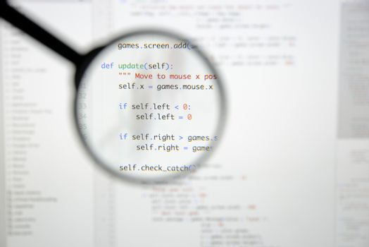 Real Python code developing screen. Programing workflow abstract algorithm concept. Lines of Python code visible under magnifying lens.