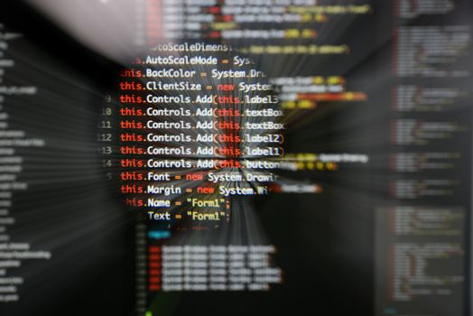 Real c# code developing screen. Programing workflow abstract algorithm concept. Lines of c# code visible under magnifying lens  with moviment effect.