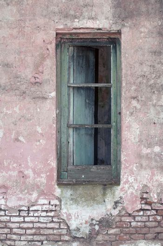 Old window on exposed brick wall.