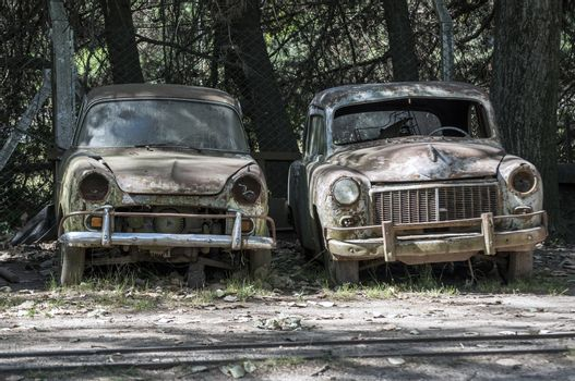 Two old, abandoned cars.