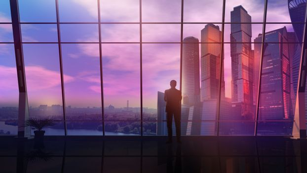 Male silhouette in a modern office opposite panoramic windows.