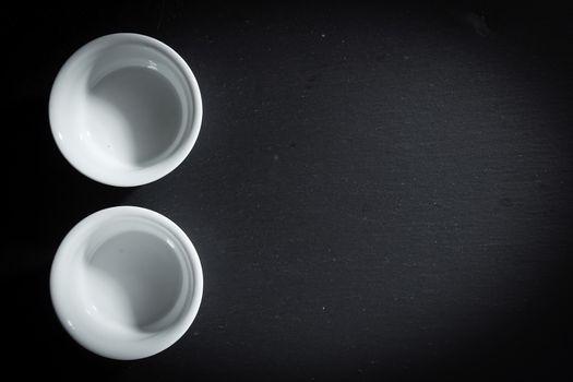 Two empty white ceramic crockery