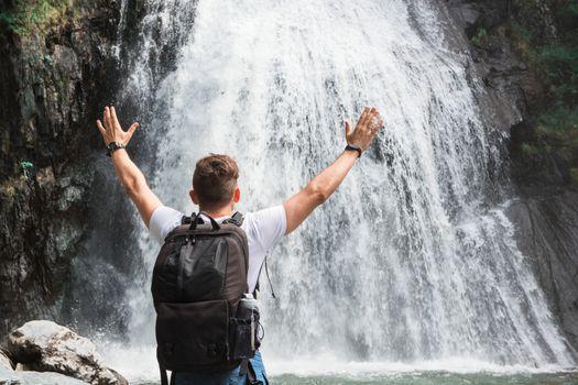 Man at Korbu Waterfall