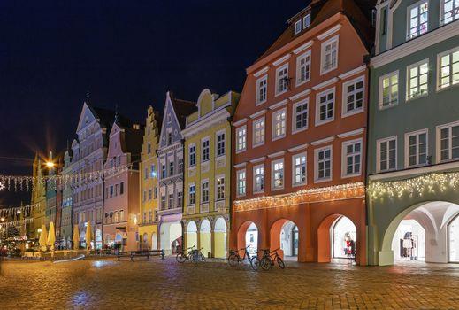 Historical houses on Altstadt street in Landshut in evening, Germany
