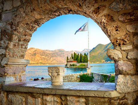 View on St George island from Our Lady of the Rocks through arch. Perast, Montenegro