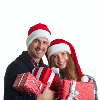 Happy beautiful couple holding many christmas gifts isolated on white background