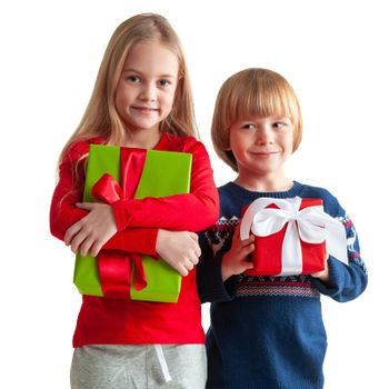 Portrait of two happy children with Christmas gift boxes isolated on white background