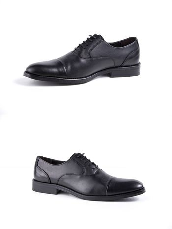 Male black leather shoes on white background, isolated product.