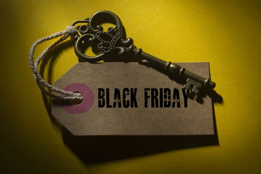 Creative for Black Friday with a label and an old key