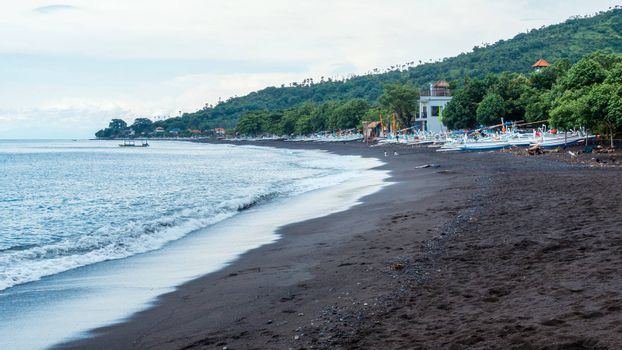 The black sand beach of Amed in Bali, Indonesia