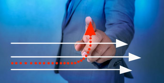 business different direction The hand of a business man is pointing to a business change point
