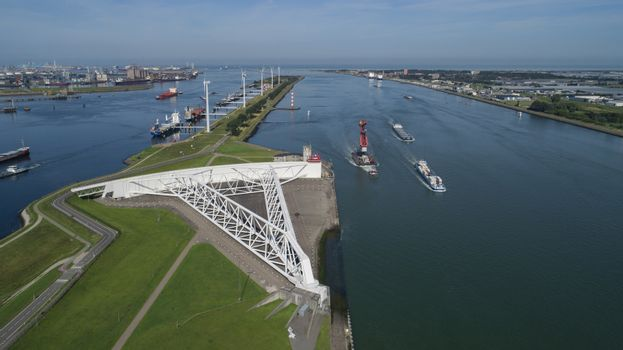 Aerial picture of Maeslantkering storm surge barrier on the Nieuwe Waterweg Netherlands it closes if the city of Rotterdam is threatened by floods and is one of largest moving structures on earth