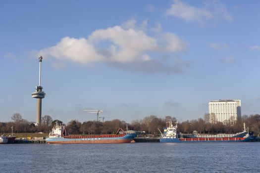 view on euromast and cityscape of Rotterdam from river bank on sunny october day - Image