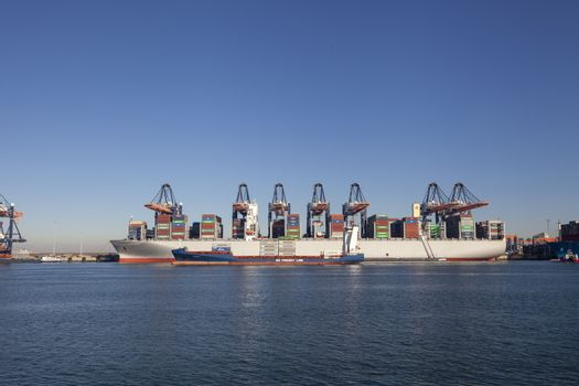 Panoramic view of the container ships, unloading and loading in the terminal of Port of Rotterdam, the netherlands