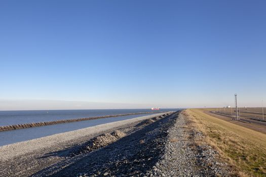 Concrete breakwaters. Seascape with concrete tetrapodes to protect coastal structures from destructive impact of storm sea waves. Strengthening of concrete sea.