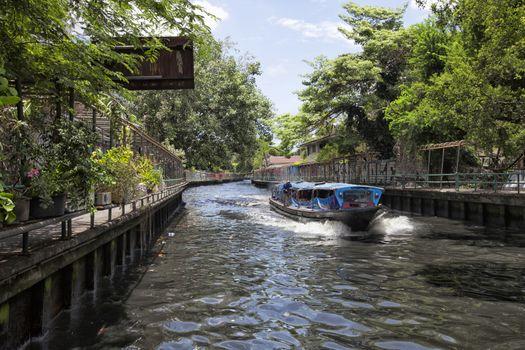 River boat transporting passengers and tourist down Chao Praya river , Bangkok , Thailand