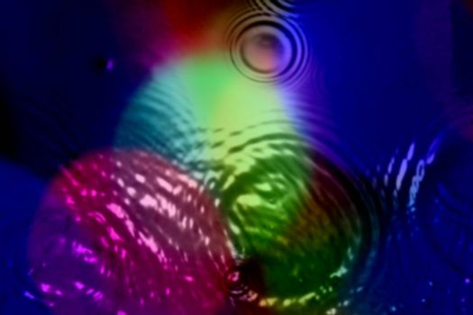 An abstract background of ripples in different patterns of psychedelic colors.
