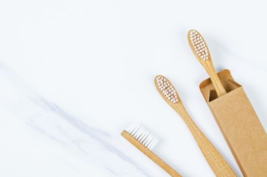 Bamboo toothbrushes on marble background. Zero waste concept.