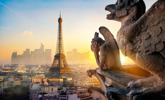 Stone Chimera and Eiffel Tower at sunset in Paris, France