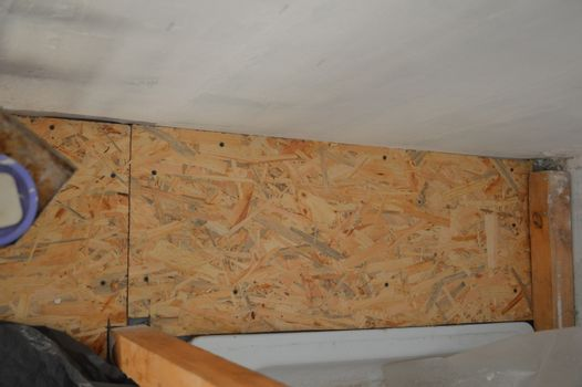 Laying chipboards in the interior of  house osb stove