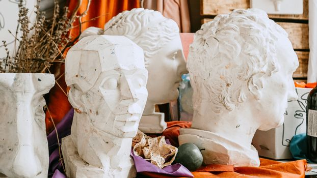 Sculpture bust and tools in an art workshop
