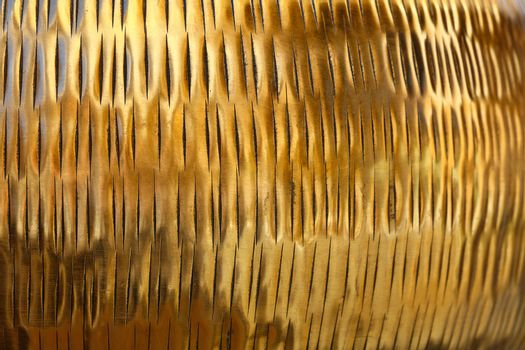 Background texture of shiny golden metal surface