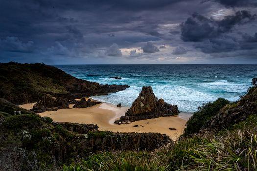 Stormy skies over coastal landscape with impressive sea stacks