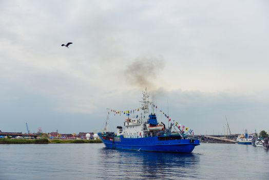 Transport vessels depart from the port to the open Baltic Sea