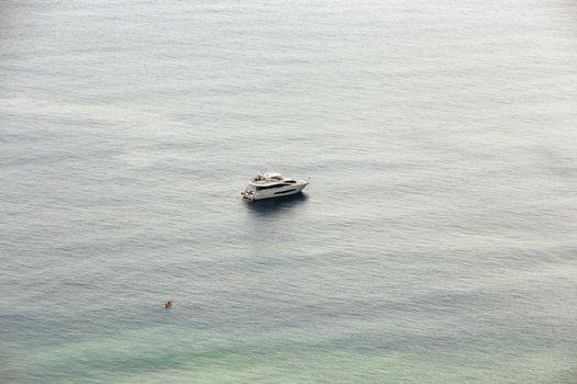 Orange kayak and a yacht