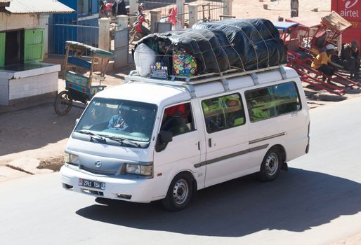 Madagascar on july 25, 2019 - Overloaded bus moves through the v