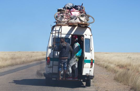Madagascar on july 30, 2019 - Overloaded bus moves through the v