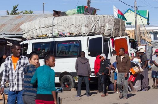 Madagascar on august 1, 2019 - Overloaded bus moves through the