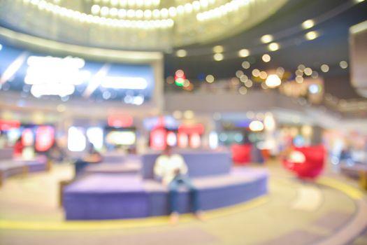 Blur of Defocus Background of People Waiting in Movie or Cinema Complex Lounge