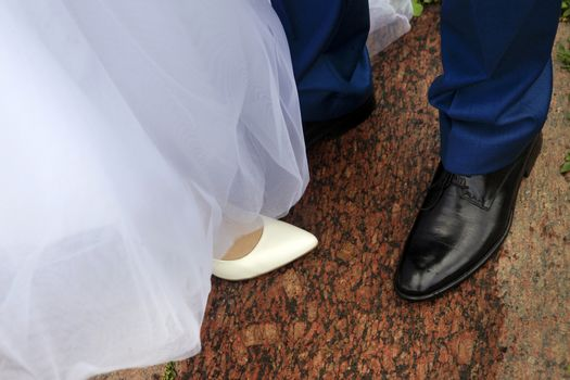 Legs of the groom and the bride