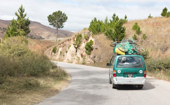 Madagascar on july 27, 2019 - Overloaded bus moves through the v