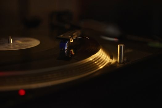Vintage turntable while playing a vinyl record.