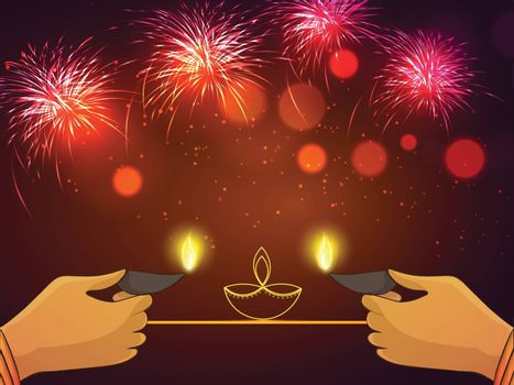 Women's hand holding illuminated Oil Lamps (Diya) on shiny fireworks background for Indian Festival of Lights, Happy Diwali celebration.