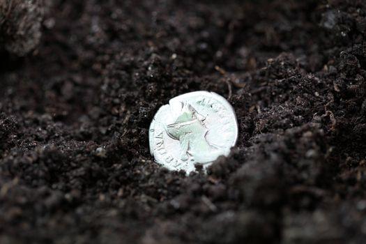 Silver denarius in the ground