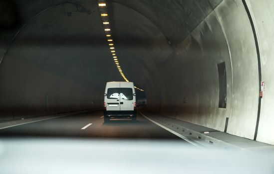 Bus traveling in highway tunnel.