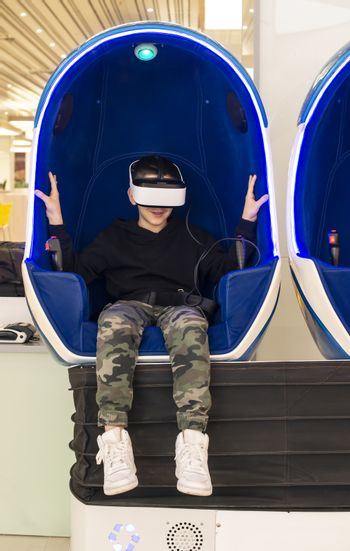 Child watching movie with VR glasses. Special effects. Technolog
