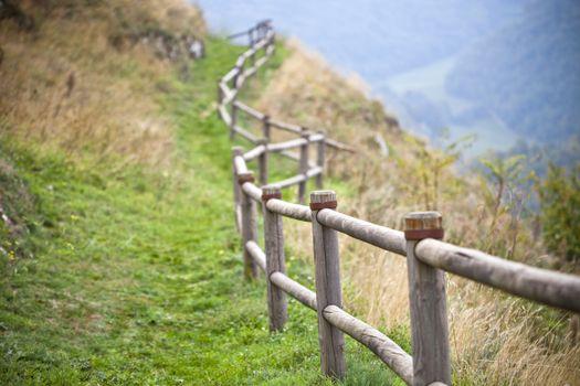 Italian landscape, hills and wooden handrails.