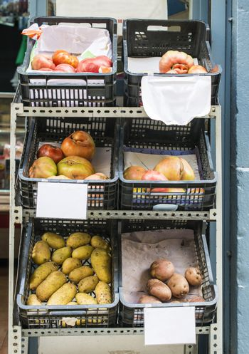 Tomatoes and potatoes in authentic shop