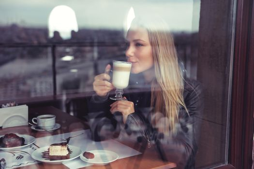 Happy woman in cafe