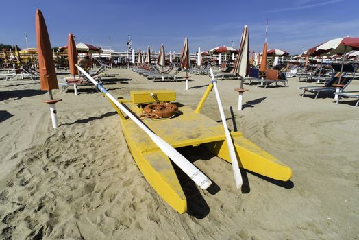 Lifeboat on the beach. Italian beach