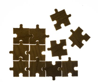 Wooden puzzle and backlight background