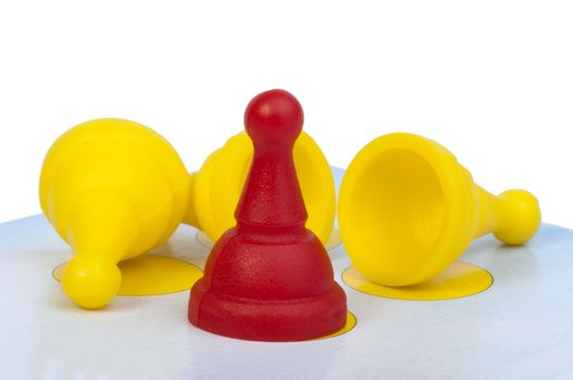 Red and yellow game pawns white isolated